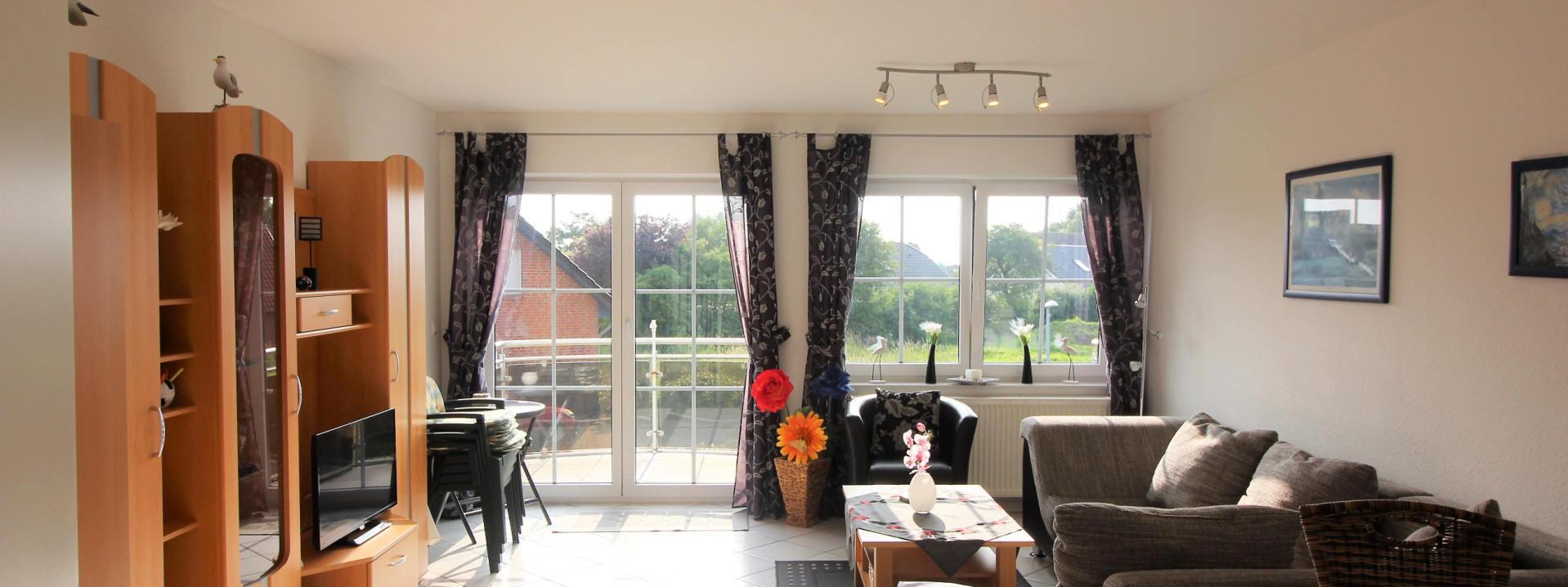 Haus Sonnenstrahl Wohnzimmer im Küstenbadeort Dorum-neufeld